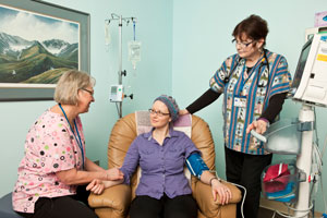 nurses with patient in treatment room