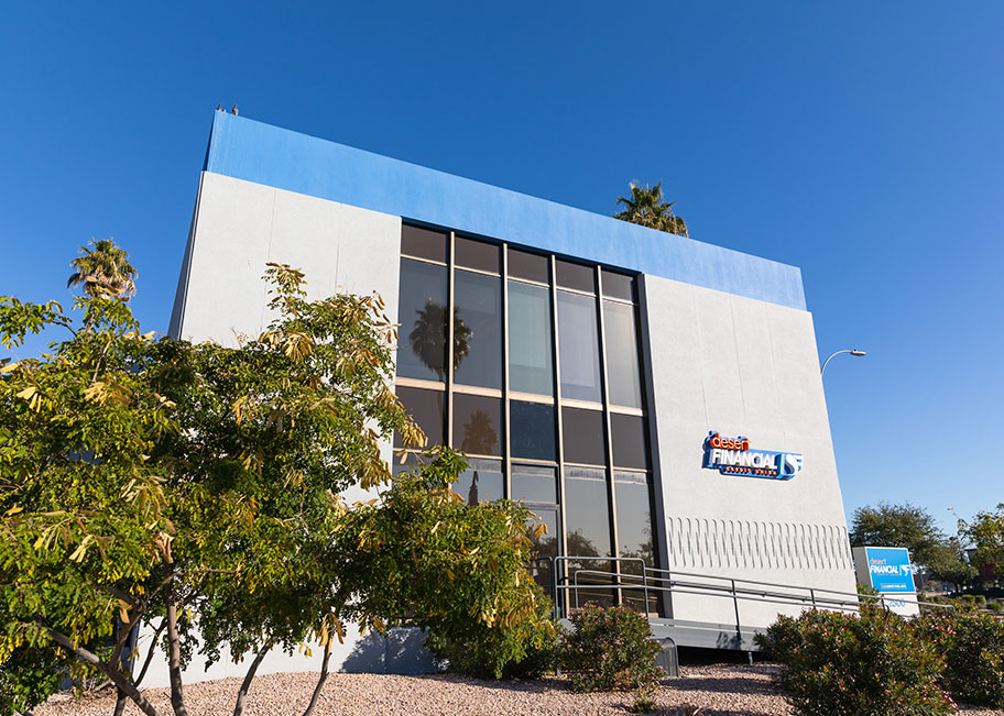 colorful blue and orange exterior of new desert financial branch building
